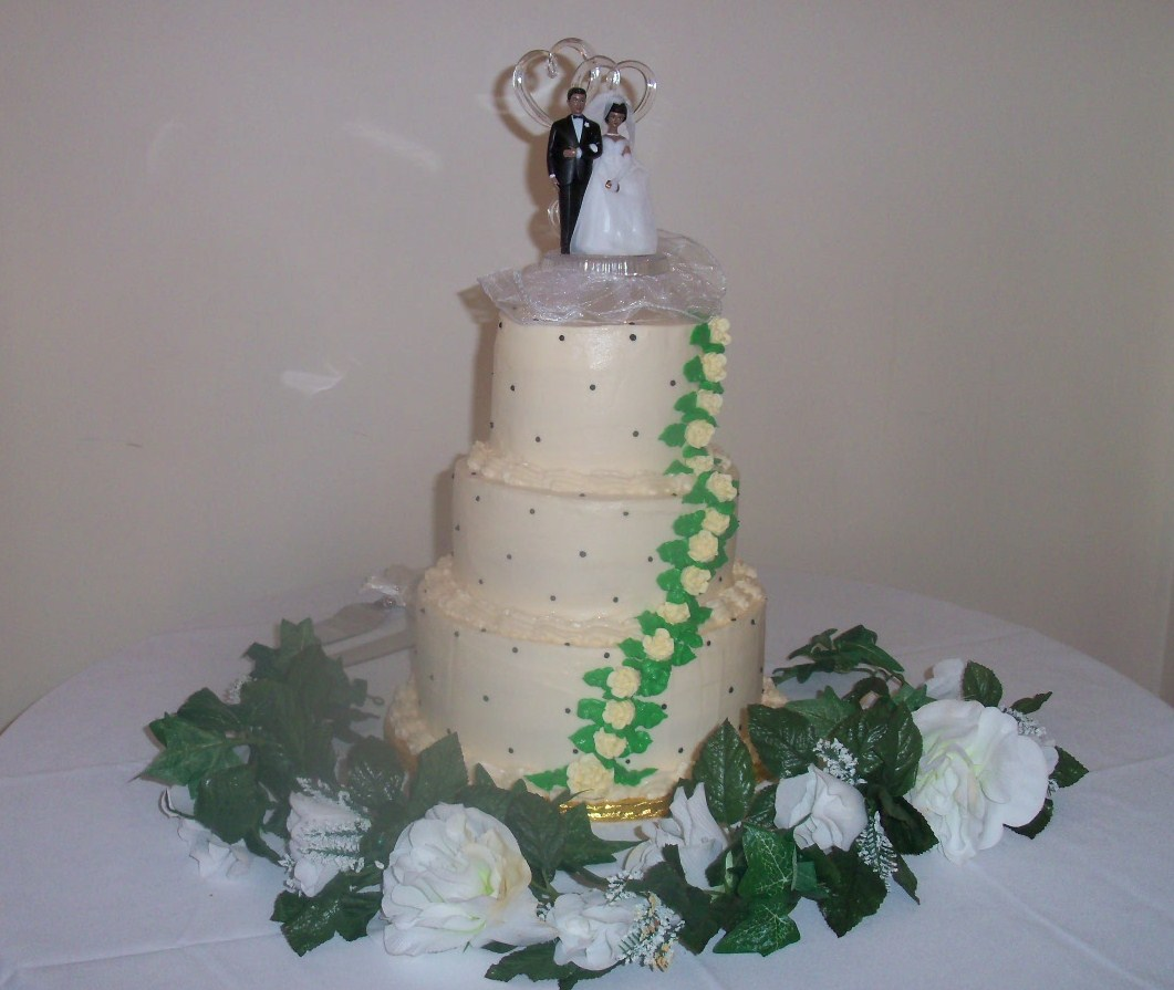 Triple Tiers with Cascading Flowers Cake Bakery